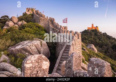 Moorish Castle and Pena Palace at sunset in Sintra, Portugal. - Stock Photo