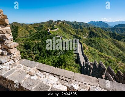 Ming dynasty Jinshanling Great Wall of China with watchtowers leading into distance on mountain ridge, China, Asia