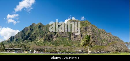 Kualoa, HI - 24 January 2020: Panorama of the mountains behind Kualoa Ranch, a tourist attraction on Oahu - Stock Photo