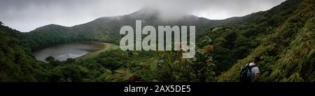 Cloud forest in Nicaragua hiking among the vegetation around a mountain lake - Stock Photo