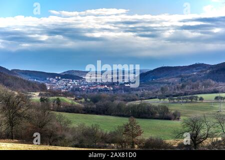 Small town Tisnov in the Czech Republic - Europe. View of the city between hills. February without snow.. Sunny day in the countryside. - Stock Photo