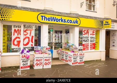The rather scruffy exterior and entrance to TheWorks.co.uk store in Devizes Wiltshire UK - Stock Photo