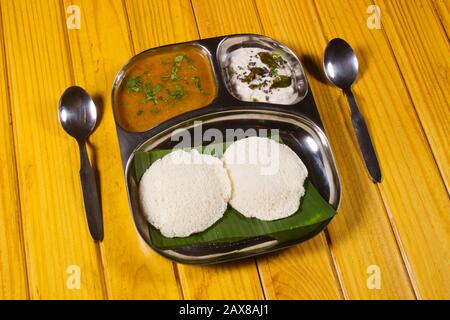 Idli Sambar and chutney. Traditional South Indian breakfast made of fermented rice and black gram batter and steamed in molds. - Stock Photo