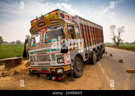 India, Rajasthan, Hindaun, truck up to axle in sand after running off road - Stock Photo