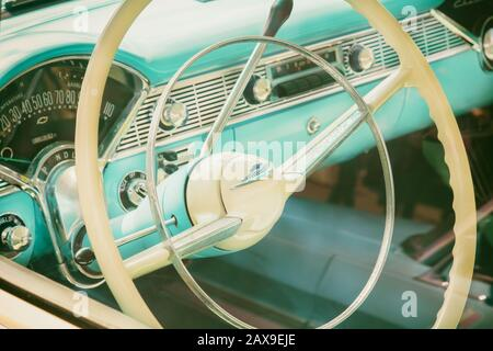 DEN BOSCH, THE NETHERLANDS - MAY 12, 2019: Retro styled image of the interior of a classic blue Cadillac fifties car in Den Bosch, The Netherlands - Stock Photo