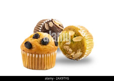Different kinds of freshly baked banana muffins on white background with clipping path - Stock Photo