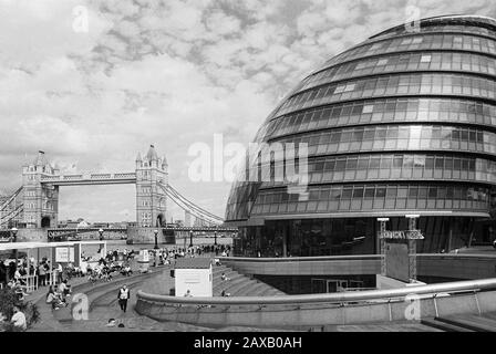 City Hall and Tower Bridge on the South Bank of the Thames in central London UK - Stock Photo