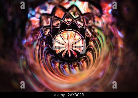Bright and colorful rainbow colored and festive abstract background with a patterned mandala like shape in the middle - Stock Photo