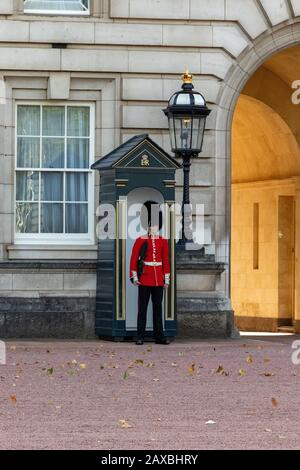 London, England - September 18, 2018: Queen Soldier Guard in Buckhingham Palace in London - Stock Photo
