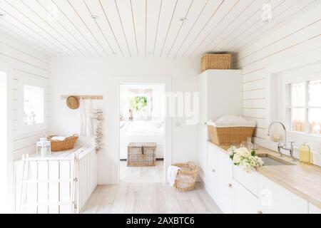 White wood shiplap home showcase laundry room - Stock Photo