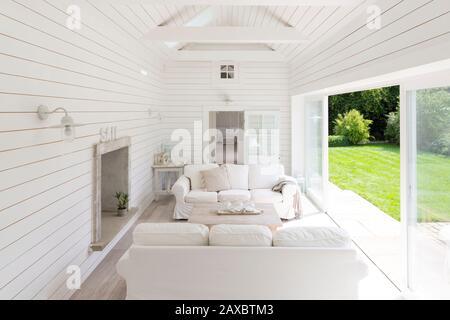 White wood shiplap a-frame home showcase sunroom - Stock Photo