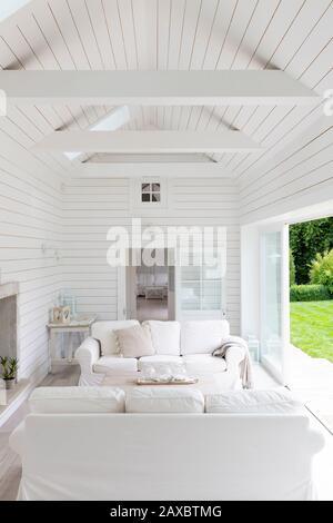White wood shiplap a-frame home showcase living room - Stock Photo
