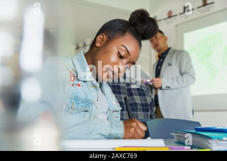 Focused high school girl student studying in classroom - Stock Photo