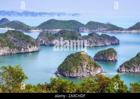Limestone karst scenery in Halong Bay, North Vietnam. - Stock Photo