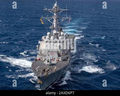The U.S. Navy Arleigh Burke-class guided-missile destroyer USS Gridley conducts maneuvering exercises during operations January 4, 2020 in the Atlantic Ocean. - Stock Photo