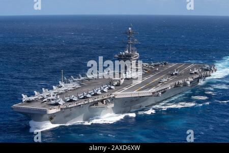 The U.S. Navy Nimitz-class nuclear powered aircraft carrier USS Theodore Roosevelt transits the Pacific Ocean in January 25, 2020 in the Pacific Ocean. - Stock Photo