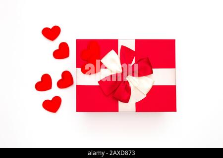 Gift or gift box, red heart on white background top view. Greeting card for Valentine's Day. - Stock Photo