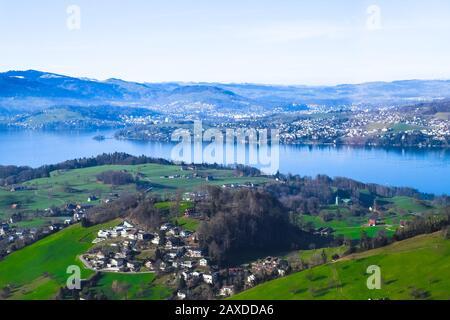 Panaramic skyline view of Weggis, Vierwaldstattersee, Lake Lucern, Switzerland, taken from inside a cable lift cabin. - Stock Photo
