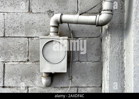 an unused grey painted wall utility box - Stock Photo
