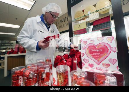 St. Louis, United States. 11th Feb, 2020. Chocolate Chocolate Chocolate owner Dan Able, stacks boxes for display for Valentines Day, in St. Louis on Tuesday, February 11, 2020. Photo by Bill Greenblatt/UPI Credit: UPI/Alamy Live News - Stock Photo