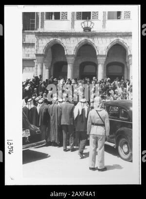 'English: Title: 'Coronation' of King Abdullah in Amman. Crowds at palace awaiting king's return from the mosque Abstract/medium: G. Eric and Edith Matson Photograph Collection  Physical description: 1 transparency :; 1946; Library of Congress Catalog: https://www.loc.gov/pictures/collection/matpc/item/mpc2005010235/PP Original url: https://hdl.loc.gov/loc.pnp/matpc.14991; Matson Collection; ' - Stock Photo