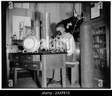 'English: Title: Add record depth reached by Navy divers. E.B. Crosby, Boatswain's Mate, 1st Class, U.S.N., rebreathing into a special apparatus which measures the amount of helium gas absorbed by body after a dive into the tank at Washington Navy Yard,. 8/9/38 Abstract/medium: 1 negative : glass ; 4 x 5 in. or smaller; 1938; Library of Congress Catalog: https://lccn.loc.gov/2016873868 Image download: https://cdn.loc.gov/master/pnp/hec/24800/24897a.tif Original url: https://www.loc.gov/pictures/item/2016873868/; Harris & Ewing, photographer; ' - Stock Photo