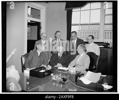 'English: Title: Admiral Leahy confers with Puerto Rican officials about new post as Governor. Washington, D.C., June 14. Admiral William D. Leahy, who is scheduled to be the next governor of Puerto Rico met today at his office with a group of Puerto Rican political leaders to discuss his new post. Left to right: Martinez Nadal, President of the Puerto Rican Senate, Santiago Iglesias, Resident Commissioner, Admiral Leahy, standing; Fernando Geigel, City Manager of San Juan, P.R., Alfonso Valdez, Puerto Rican Senator, Bolivar Pagan, Vice President of the Puerto Rican Senate, and Luis Obergh, co - Stock Photo