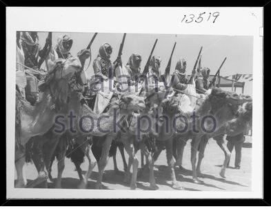 'English: Title: 'Coronation' of King Abdullah in Amman. Cavalry of the Arab Legion in march past parade Abstract/medium: G. Eric and Edith Matson Photograph Collection  Physical description: 1 transparency :; 1946; Library of Congress Catalog: https://www.loc.gov/pictures/collection/matpc/item/mpc2005010238/PP Original url: https://hdl.loc.gov/loc.pnp/matpc.14994; Matson Collection; ' - Stock Photo