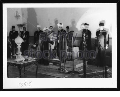 'English: Title: 'Coronation' of King Abdullah in Amman. Sheik handing King Abdullah proclamation of the crowning Abstract/medium: G. Eric and Edith Matson Photograph Collection  Physical description: 1 transparency :; 1946; Library of Congress Catalog: https://www.loc.gov/pictures/collection/matpc/item/mpc2005010234/PP Original url: https://hdl.loc.gov/loc.pnp/matpc.14990; Matson Collection; ' - Stock Photo