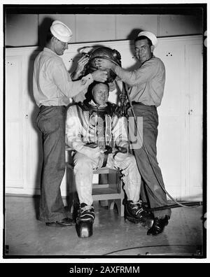 'English: Title: Add record depth reached by Navy divers. William Badders, Master Diver, U.S.N., who recently made a record dive of over 500 feet, is helped into his underwater suit just before taking an experimental dive in the tank at Washington Navy Yard, 8/9/38 Abstract/medium: 1 negative : glass ; 4 x 5 in. or smaller; 1938; Library of Congress Catalog: https://lccn.loc.gov/2016873866 Image download: https://cdn.loc.gov/master/pnp/hec/24800/24895a.tif Original url: https://www.loc.gov/pictures/item/2016873866/; Harris & Ewing, photographer; ' - Stock Photo