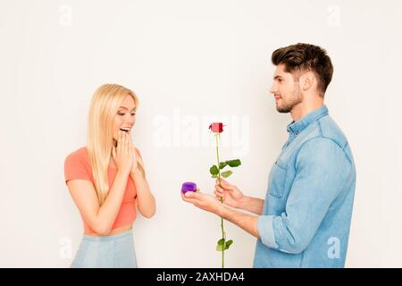 Happy man doing marriage proposal to his girlfriend - Stock Photo