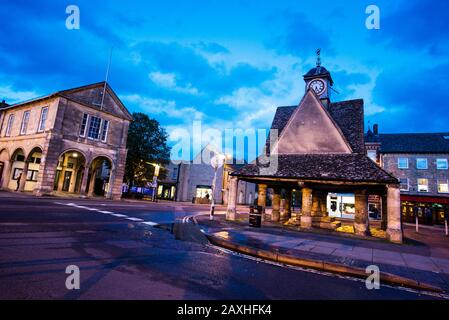 The buttercross in the market square of historic Witney, England was built around 1600 and was where farmers from all over sold butter and eggs. Stock Photo
