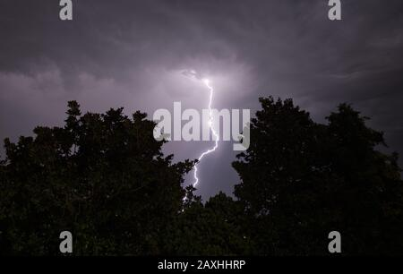 Lightning strikes during a heavy storm in Italy Stock Photo