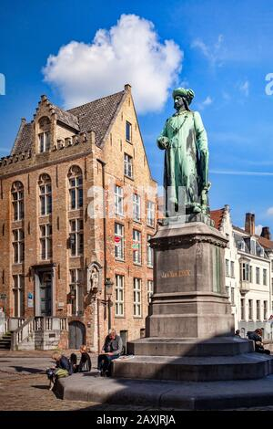 25 September 2018: Bruges, Belgium - Statue of the 15th century painter, Jan van Eyck, standing in the square which bears his name in Bruges. Modern... - Stock Photo