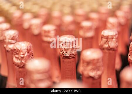 the pattern of the same white or gold champagne bottles, celebration of the holiday - Stock Photo