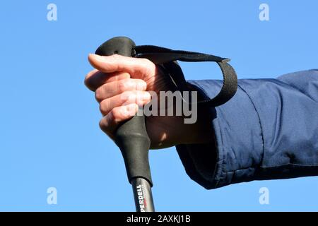 Wrist strap on trekking pole. Incorrect use. - Stock Photo
