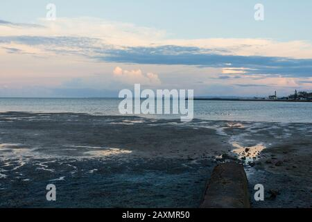 Scenic view of sea against dramatic sky during sunset - Stock Photo