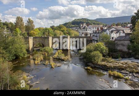 Llangollen is a small town and community in Denbighshire, north-east Wales, on the River Dee at the edge of the Berwyn mountains - Stock Photo