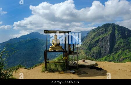Buddha statue in the Little Adam's Peak in Ella, Sri Lanka. - Stock Photo