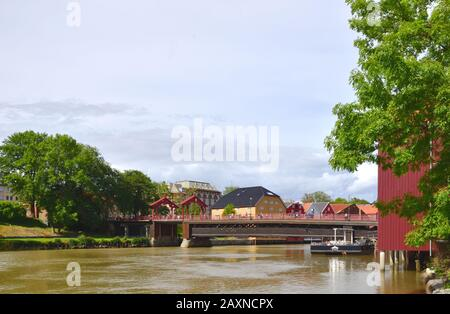 The Old Town Bridge (Gamle Bybro) spans the Nidelva River in the Bakklandet district of Trondheim, Norway. - Stock Photo