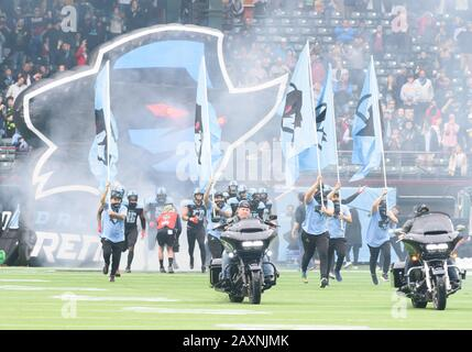 Arlington, Texas, USA. 9th Feb, 2020. Motorcycles and players come on the field before the 1st half of the XFL game between St. Louis Battlehawks and the Dallas Renegades at Globe Life Park in Arlington, Texas. Matthew Lynch/CSM/Alamy Live News - Stock Photo