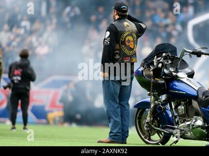 Arlington, Texas, USA. 9th Feb, 2020. Combat Vet's Association member solutes the flag during the national anthem at the XFL game between St. Louis Battlehawks and the Dallas Renegades at Globe Life Park in Arlington, Texas. Matthew Lynch/CSM/Alamy Live News - Stock Photo