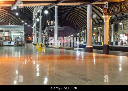 First Transpennine Express class 185 at a deserted Newcastle central railway station early in the morning. - Stock Photo