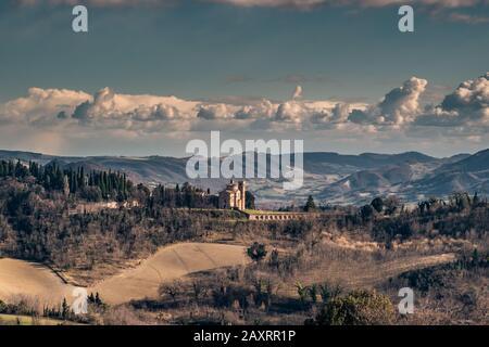 Countryside around Urbino with the church of saint Bernardino where is the tomb of the Duke Federico IV of Montefeltro. Urbino, Marche, italy. - Stock Photo