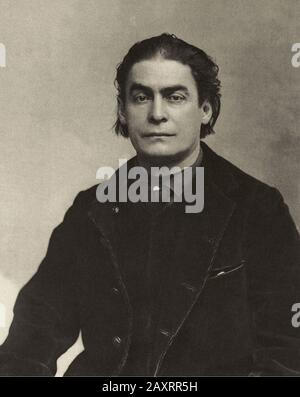Aristide Bruant (1851 – 1925) was a French cabaret singer, comedian, and nightclub owner. He is best known as the man in the red scarf and black cape - Stock Photo