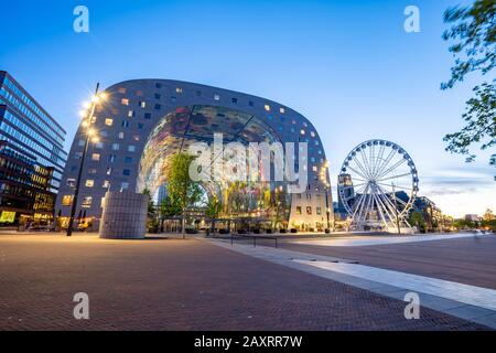 Rotterdam, Netherlands - May 13, 2019: View of Markthal at night in Rotterdam city, Netherlands. - Stock Photo