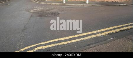 Pot hole on a road surface - Stock Photo