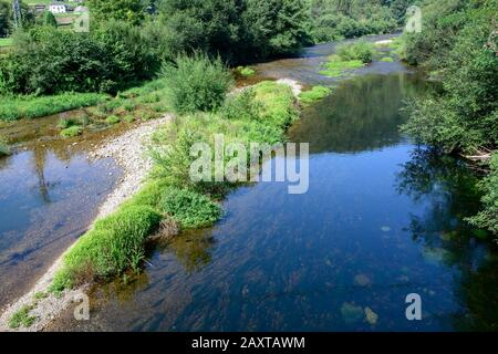 mountain river with a lot of flow due to frequent rains in asturias - Stock Photo