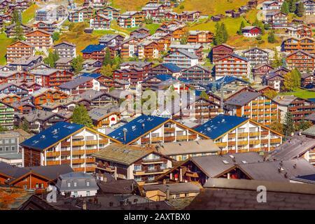 Zermatt, Switzerland town aerial view in famous swiss ski resort, colorful traditional houses