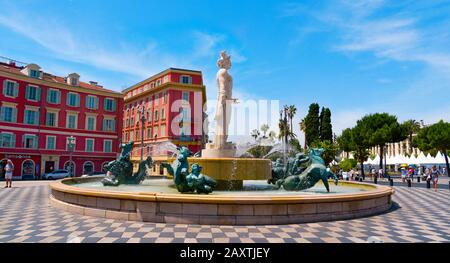 NICE, FRANCE - JUNE 4, 2017: A view of the fountain Fontaine du Soleil at the Place Massena square in Nice, France. The Place Massena is the main publ - Stock Photo